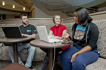 MTSU seniors David Hiller, left, and Mary Helmbrecht and junior Andréa Boyer study in the lobby of MTSU's College of Education Building. (MTSU photo by Andy Heidt)