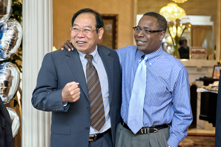 MTSU President Sidney A. McPhee, right, jokes with Professor Meng Fanxin, chairman of the board for China Agriculture University's International College, during a May 10 reception for CAU delegates visiting MTSU. (MTSU photo by J. Intintoli)