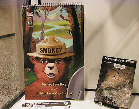 "A bilingual biography of Smokey the Bear and guides to the Blue Ridge Parkway and Mammoth Cave are part of a special ""Federal Depository Library Program"" Centennial exhibit at Walker Library. (photo submitted)"